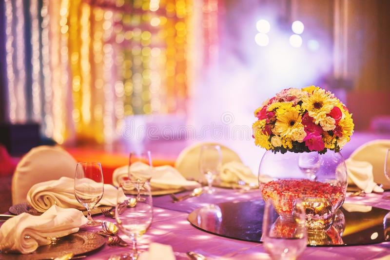 Colorful wedding reception dinner table decoration with flower bouquet stock photos