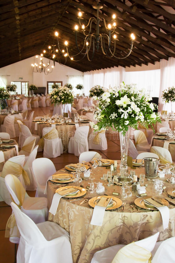 Wedding reception hall with laid tables. Wedding reception hall with tables, flowers and decor royalty free stock images