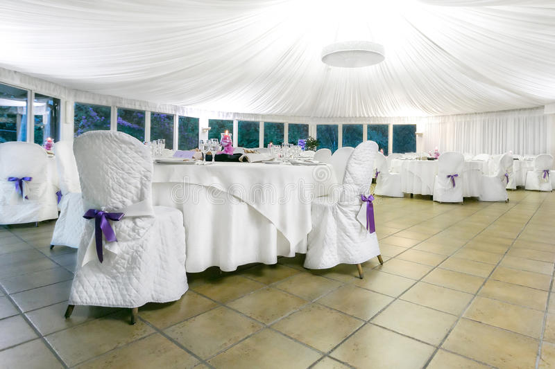Wedding reception indoor. Tables decorated for a party or wedding reception royalty free stock images