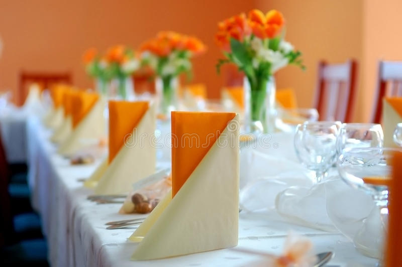 Wedding reception in orange. With tulips and white cloth royalty free stock photos