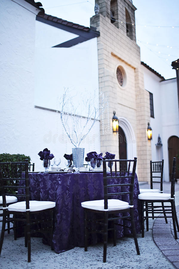 Wedding reception party table. A table set for a party or wedding reception on a castle patio stock photo