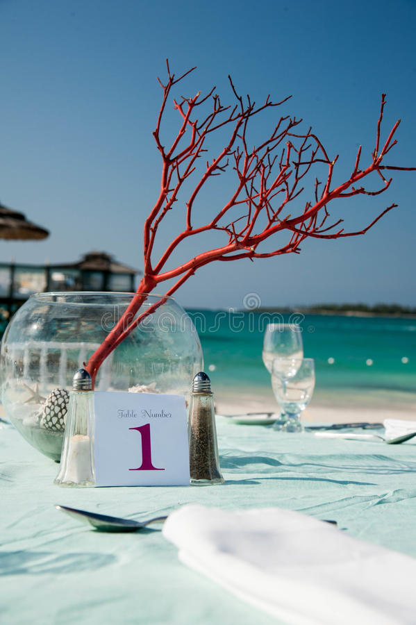 Wedding reception table number 1. Wedding reception table with centerpieces for a beach reception in tropical Nassau Bahamas royalty free stock image