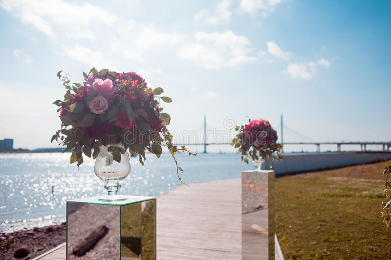 Wedding decor. Wedding registration outdoor. Luxury bouquets with red flowers royalty free stock images