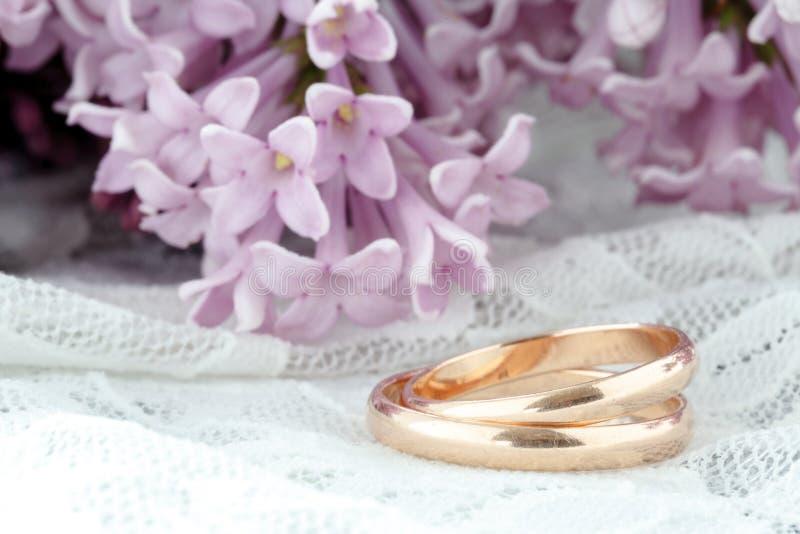 Wedding ring against flower background stock image