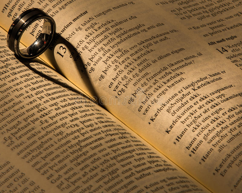 Download A wedding ring on a bible stock image. Image of shape - 31361427