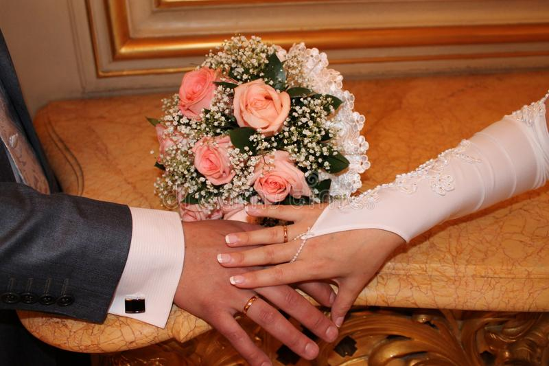 Wedding ring bouquet hands royalty free stock image