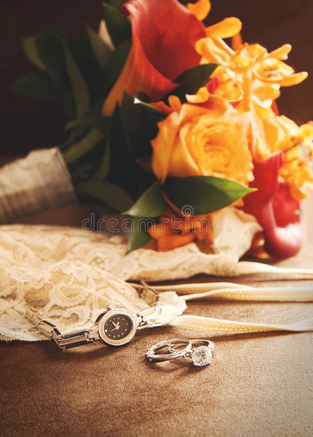 Wedding ring with bouquet on velvet royalty free stock photos