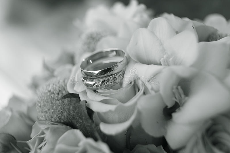Wedding ring on flowers bouqet. Wedding ring on a flowers bouqet royalty free stock photos