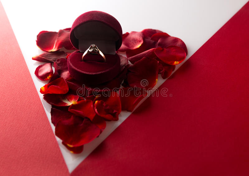 Download Wedding Ring On A Heart Of Rose Petals Corner Red White Backgrou Stock Image - Image: 83715753