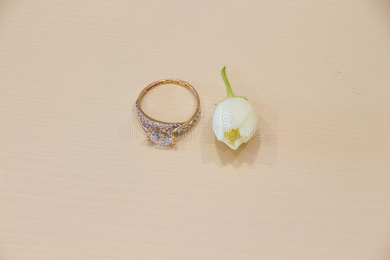 Wedding ring and Jasmine flower flat lay on pink pastel background. royalty free stock photos