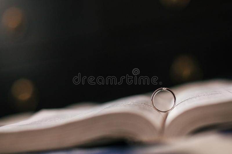 Wedding ring lies in the expanded Bible stock photo