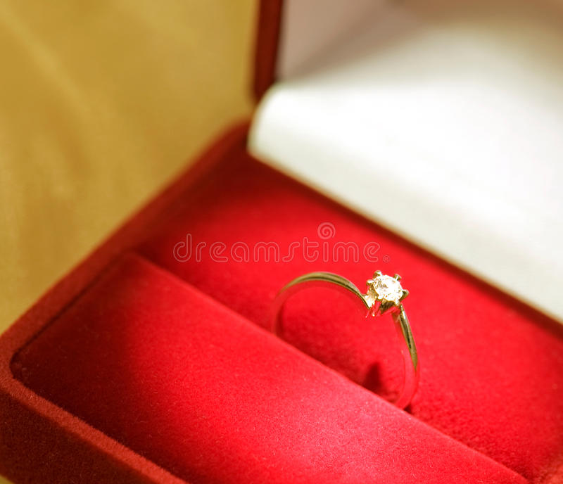 Wedding ring in a red box stock images