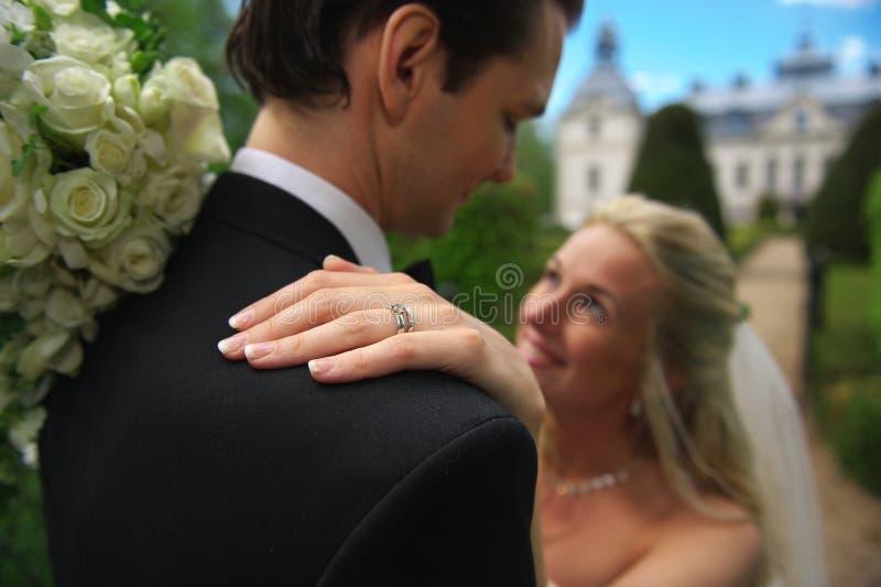Wedding ring on shoulder stock image