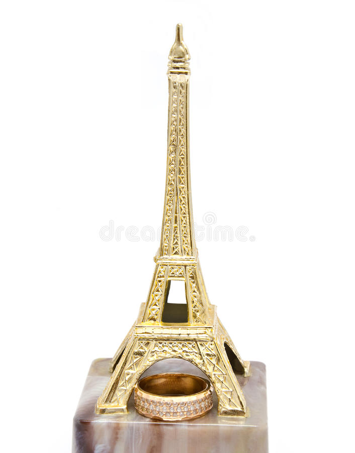 Wedding ring on the statue Eiffel Tower. Wedding ring made of gold on the statue Eiffel Tower royalty free stock photography