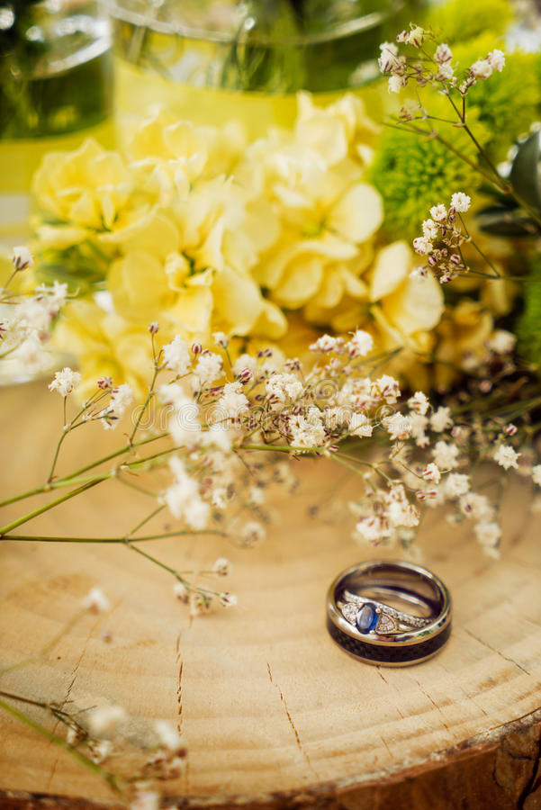 Wedding ring still life on wood with flowers royalty free stock photography