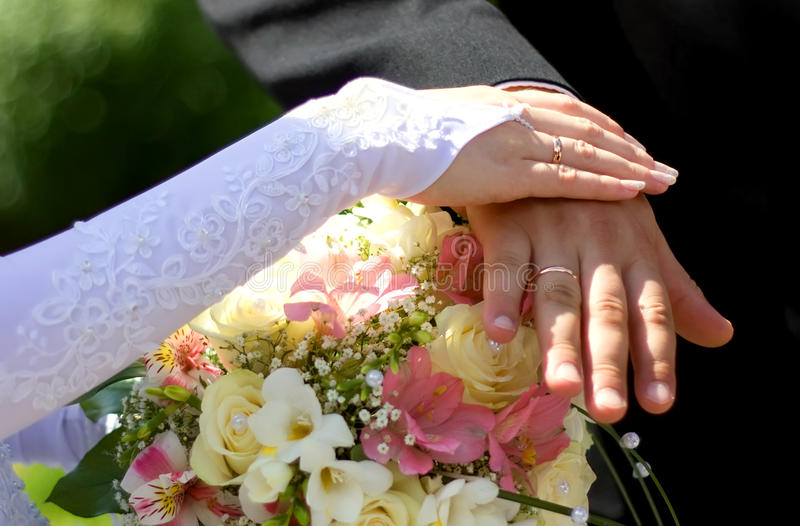 Wedding rings. Groom and bride hands with wedding rings stock photos