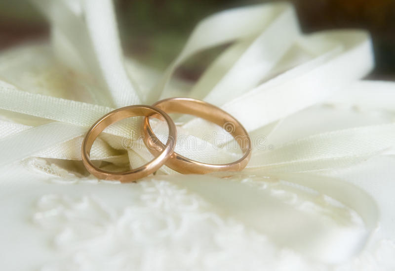 Wedding rings. Two wedding rings on the pillow royalty free stock photos