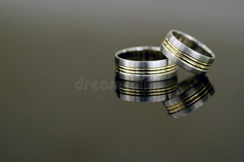 Wedding rings. On dark background royalty free stock photo