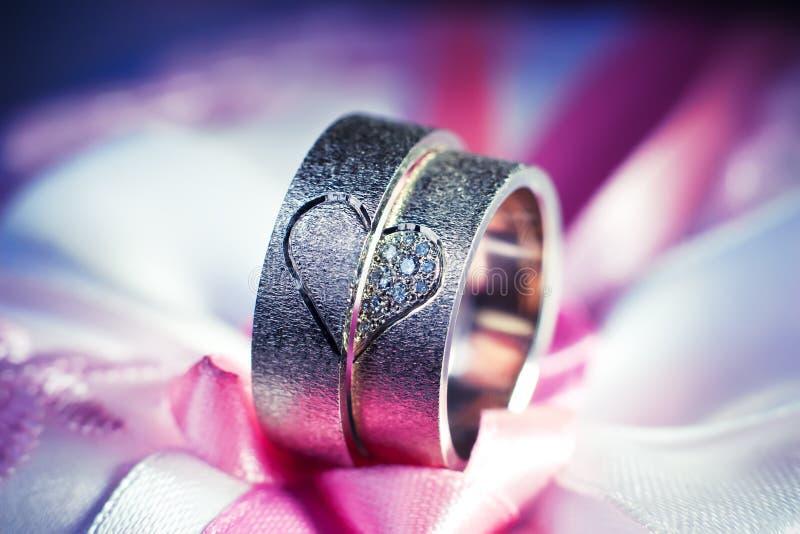 Wedding rings. On a cushion stock photos
