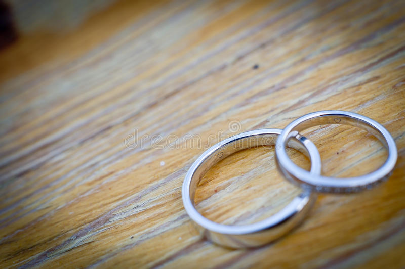 Wedding rings. On the wooden table stock photo