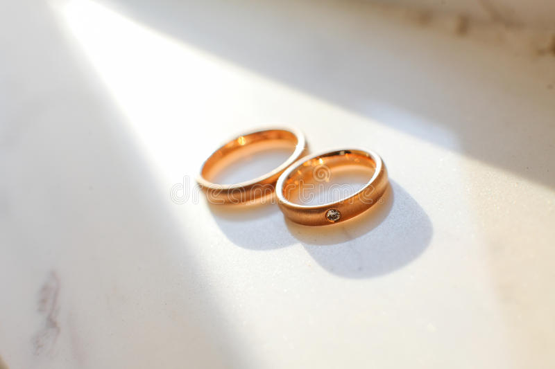 Wedding rings. On the floor stock photography