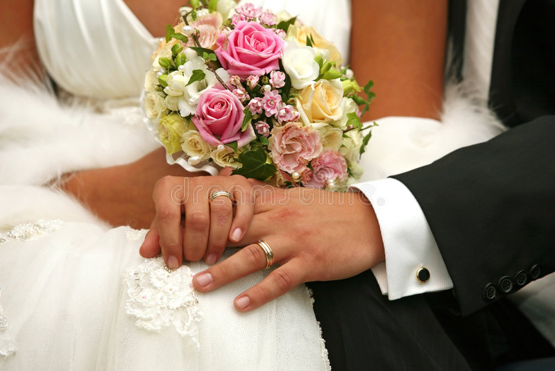Wedding rings. Hand of the groom and the bride with wedding rings