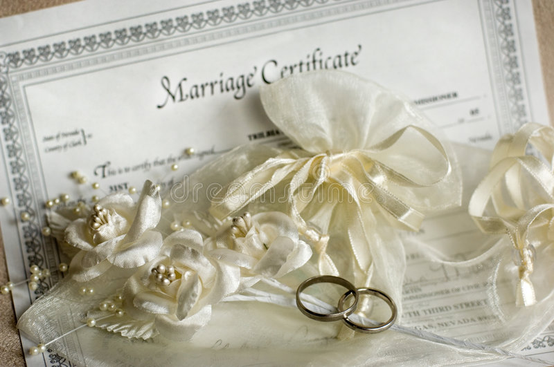 Wedding rings. Marriage certificate and wedding rings royalty free stock photos