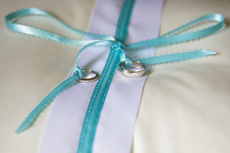 Wedding Rings. Horizontal image of wedding rings on a ringbearer's pillow stock images