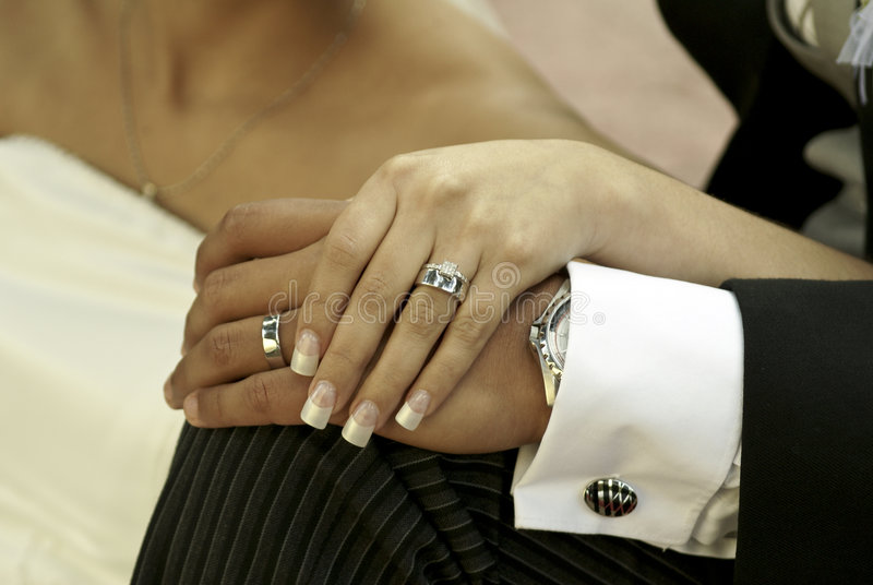 Wedding rings. Groom and the bride hands with wedding rings