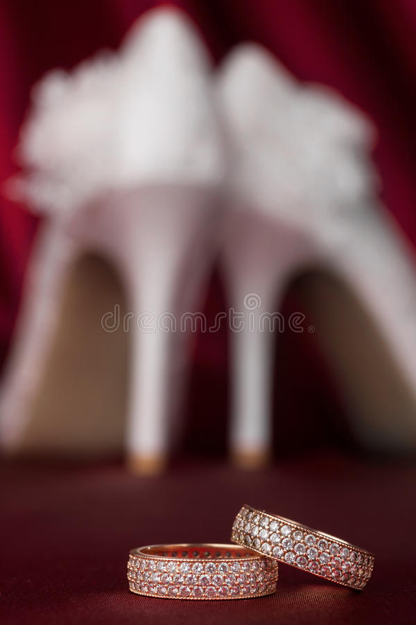 Wedding Rings On The Background Of A Pair Of Shoes Stock Photos