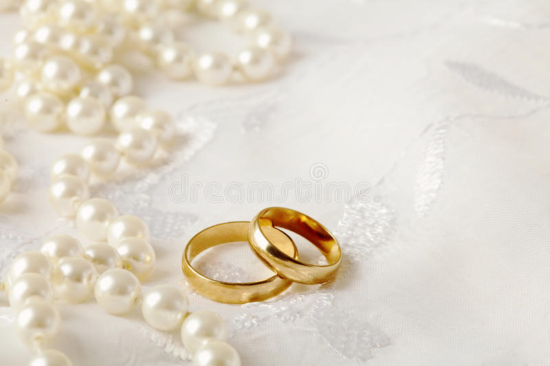 Wedding rings. Wedding background with two gold wedding rings stock images