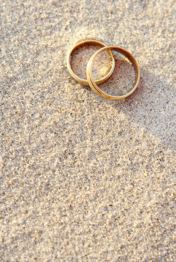 Wedding rings on the beach stock photos