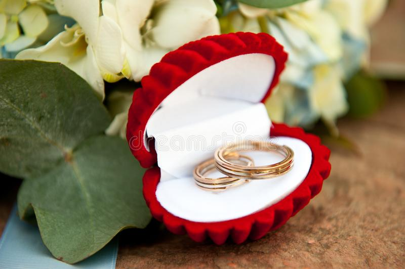 Wedding rings in a beautiful gift box and a bouquet of the bride royalty free stock photo