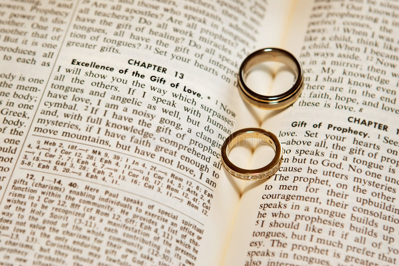 Download Wedding rings on a bible stock photo. Image of diamonds - 4331816