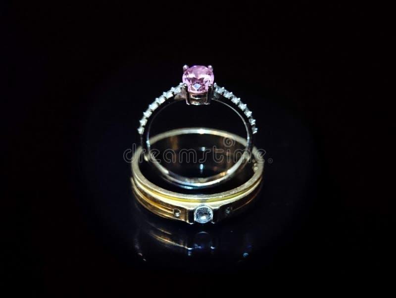 Wedding rings on black background stock photos