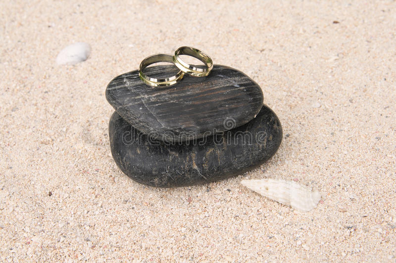 Download Wedding Rings On Black Pebbles Stock Photo - Image of happy, togetherness: 11686828