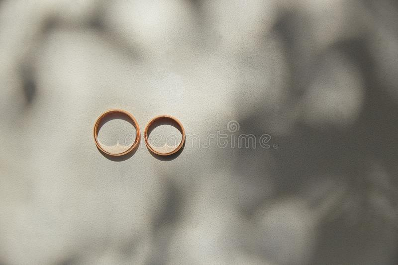 Wedding rings on black and white background royalty free stock photography