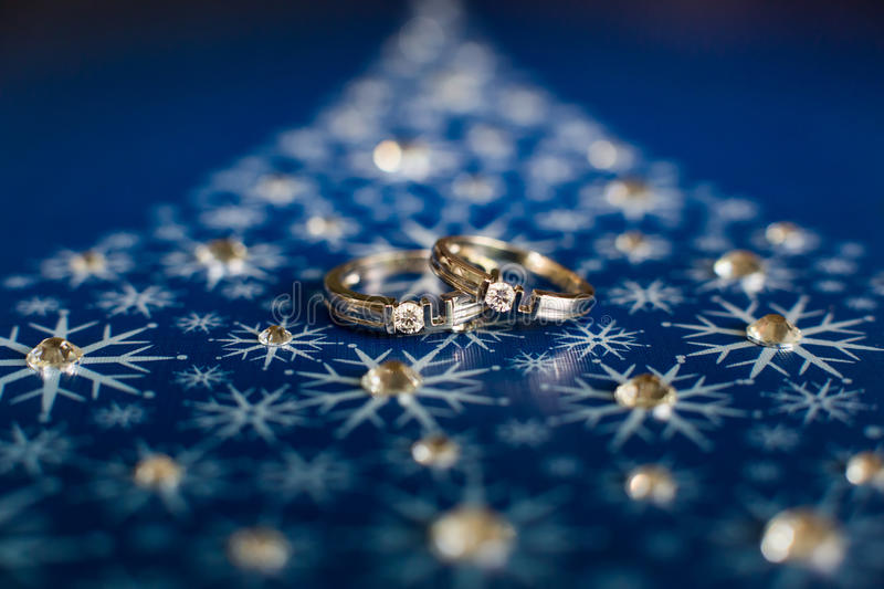 Wedding rings. On a blue background stock images