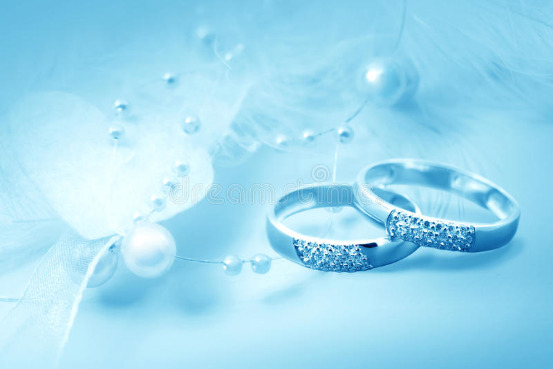 Wedding rings. On blue background for card royalty free stock image