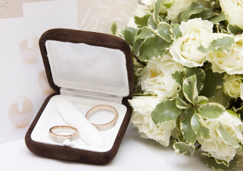 Wedding Rings And Bouquet Stock Photos
