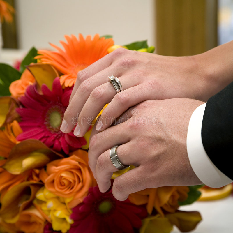 Wedding rings and bouquet stock images