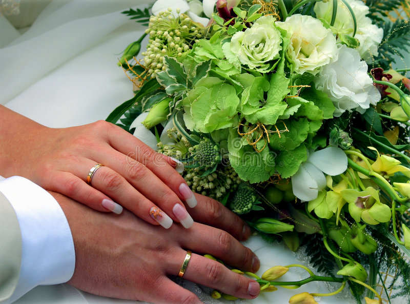 Wedding rings and bouquet stock image