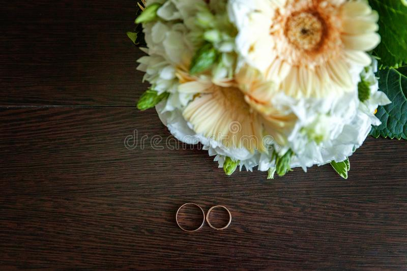 Wedding rings and bouquet stock photo