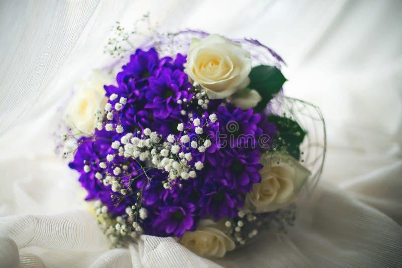 Wedding rings bouquet marriage white bride. Floral design romantic purple stock photography