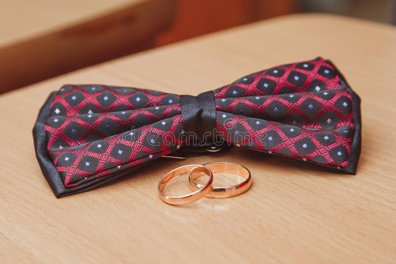 Wedding rings and bow ties on table royalty free stock images