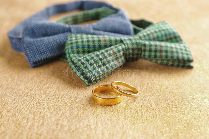 Wedding rings and bow ties royalty free stock photography