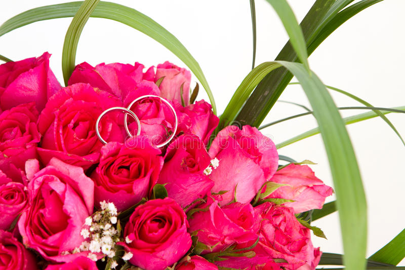 Wedding Rings And Bridal Bouquet Isolated Over Whi Stock Photos