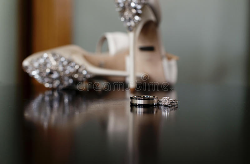 Wedding rings. And bridal shoes royalty free stock photo