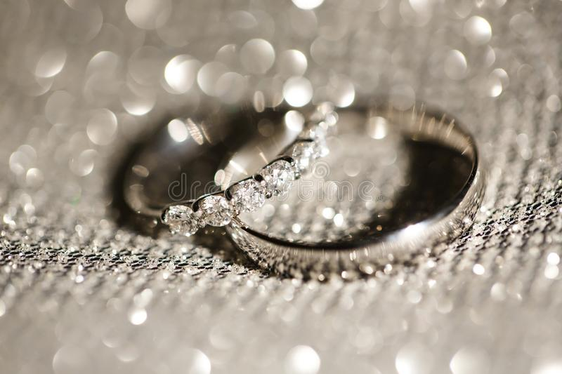 Wedding rings on a brilliant background stock photo