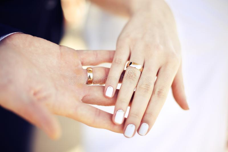 Wedding rings ceremony on the hands royalty free stock photo